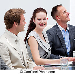 Smiling businessman in a meeting
