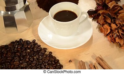 coffee - cup of coffee and coffee beans, rotating