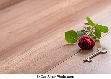 Long Stemmed Red Rose and Key on Wooden Surface - Single...