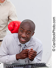 Afro-American businessman being boxed