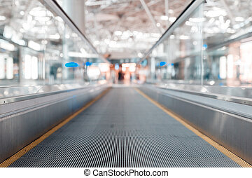 travelator at the airport and a metal roof and blurred...