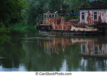 Old rusty barge and tug