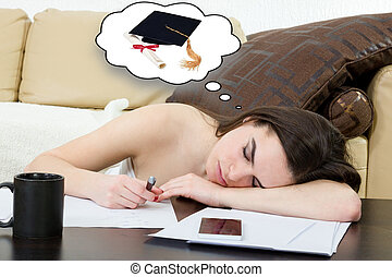 Student tired and sleeping in her living room over the notes...