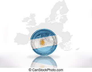 euro coin with argentinean flag on the european union map...