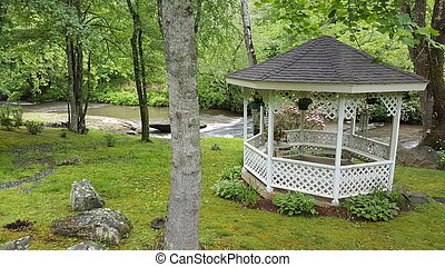 Gazebo by the creek - A gazebo near a creek in the mountains...