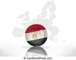 euro coin with egyptian flag on the european union map...