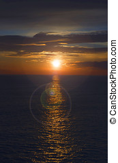 Beautiful sunset lens flare - Beautiful sunset at sea with a...