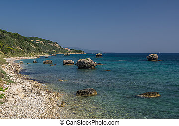 Large rock formations in a turquise rocky bay in Kefalonia -...