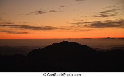 sunrsie  - silhouette of a mountain when the sun rises