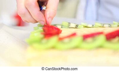 pastry chef prepares fruit cake - hands pastry chef who...