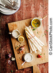 White Asparagus on Cutting Board with Herbs