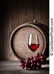Glass red wine with grapes