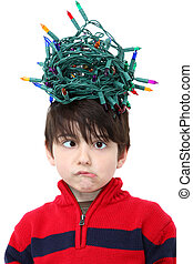 Tangled Christmas Lights - Six year old boy with tangled...