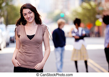 Woman City - A woman in a city setting with friends in the...