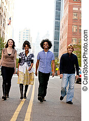 City People - A group of young adults in the city on a...