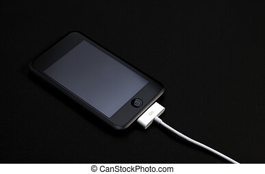 mp3 player and charger cable on black