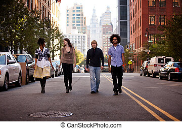 Young People in City - A group of young adults in an uban...