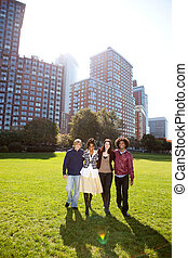 College Students - A group of college students in a park -...