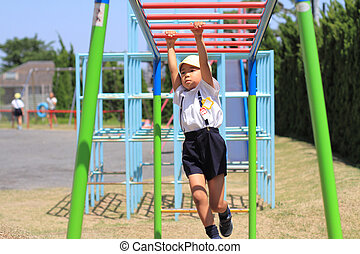 Japanese boy playing with a monkey bars (5 years old)