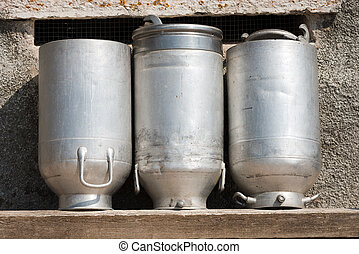 Old Milk Cans Made of Aluminum - Three old milk cans made of...