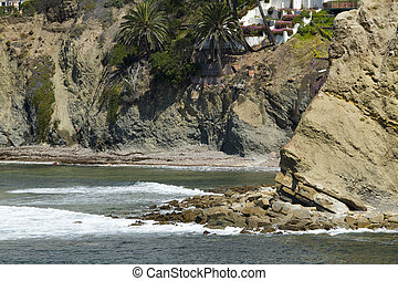 Rock Formation at a Cove on the Coast - Rocks and cliffs at...