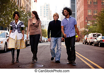 City People - A group of young people walking down a street...