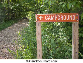 Campground Sign - Aluminum sign pointing the way, down a...
