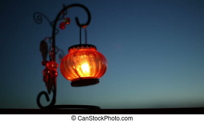 Red Lantern with a candle swaying in the wind at night