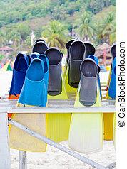 Diving fins arranged on rack
