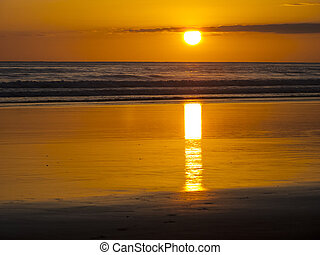 Sun sets along the North Pacific coast of Costa Rica over...