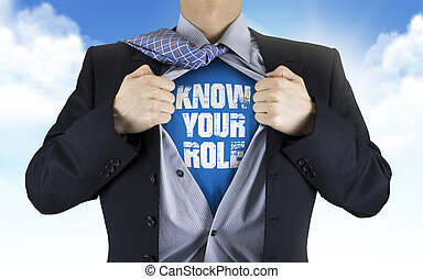 businessman showing Know your role words underneath his...