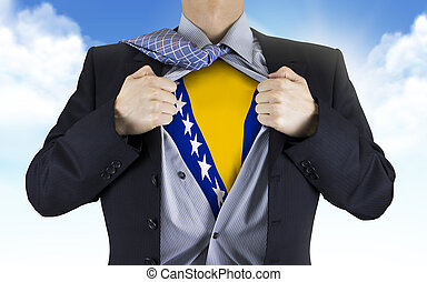 businessman showing Bosnia and Herzegovina flag underneath...