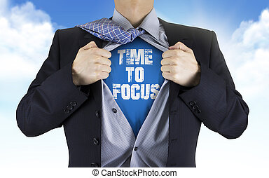 businessman showing Time to focus words underneath his shirt...