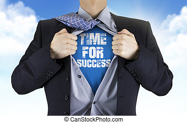 businessman showing Time for success words underneath his...