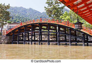 Arched Bridge (1557) of Itsukushima Shrine, Japan. UNESCO...