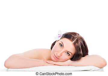 portrait of a girl in the spa salon with a flower in her hair