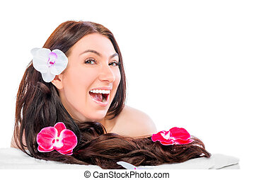 brunette girl with long hair and flowers in the studio