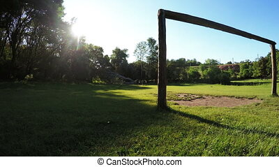 Wooden football goals - At sun backlit wooden football goals...