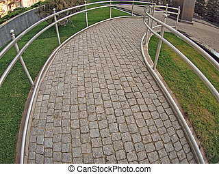 Ramp for physically challenged from the granite pavement...