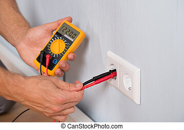 Person Hand Metering Socket Voltage - Close-up Of Person...