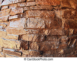 The wall of the large natural stone closeup, painted brown...
