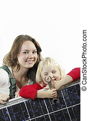 two girls - female worker and girl with photovoltaic module...