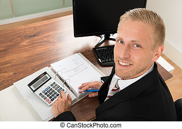 Businessman Calculating Finance - Portrait Of Happy...