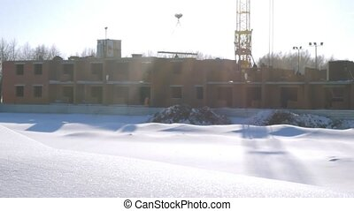 Winter foreground of a snowdrift change to construction site...
