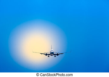 Air Travel Plane Landing Approach - Blue sky and blurred...
