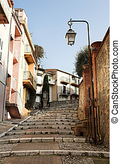 Street with walkway in Cannes - Street with buildings and...