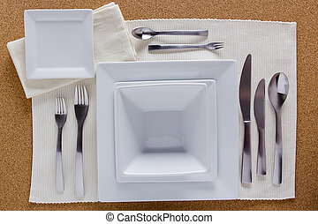 Option table setting with square plates and a complete set...