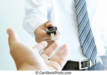 A man giving a car key