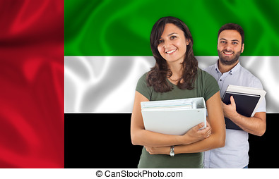 Couple of students over United Arab Emirates flag - Couple...
