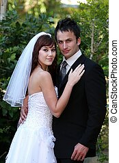 Wedding Couple Outdoors - Gorgeous smiling wedding couple on...